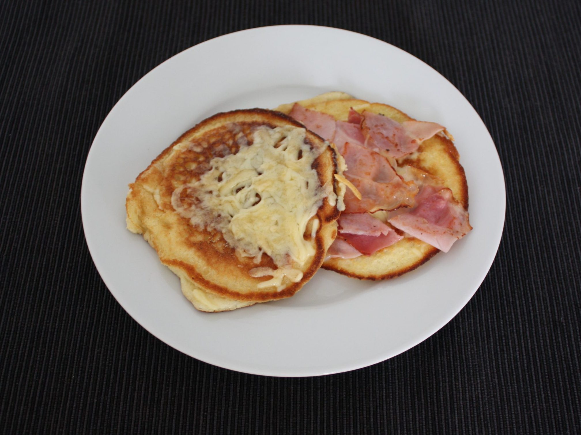 Delicious pancakes with cheese and ham